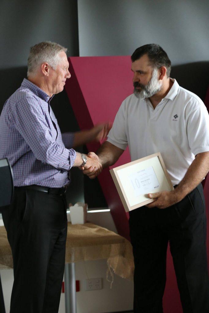 Ray celebrating Adams 10 year tenure
